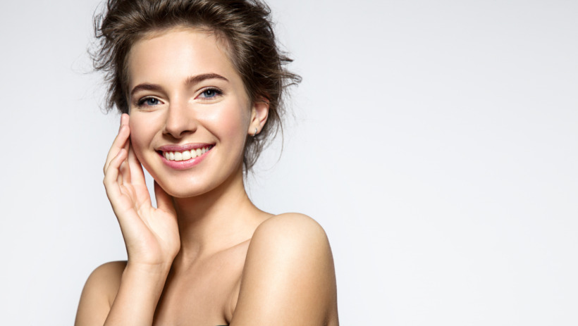 Young woman with perfect skin clean and white teeth